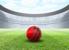 Floodlit Stadium Day. A generic seated cricket stadium with a red ball on a green grass pitch in the day time under a blue cloudy sky - 3D render vector illustration