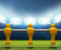 Floodlit Stadium With Foosball Players Stock Images