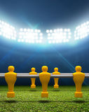 Floodlit Stadium With Foosball Players Stock Photography