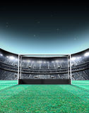 Floodlit Stadium Night. A generic seated lawn hockey stadium with a netted goal on a green grass pitch at night under illuminated floodlights - 3D render royalty free illustration