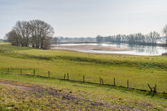 Floodplains of a Dutch river. As seen from the embankment. It is at the end of the winter season Stock Photos