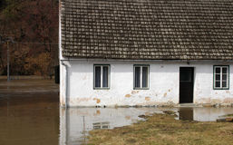 Floods. Willage house in flooded river Royalty Free Stock Photography