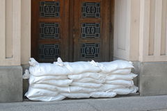 Floods protection sandbags wall. Slovak national museums side door is being prepared for potential overflow of Danube river. Photo taken in Bratislava, Slovakia Stock Photos