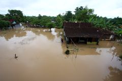 Floods in Solo. Residents of save their household furniture Seasonally flooded in the city of Solo, Central Java, Indonesia Stock Image