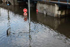 Floods in Usti nad Labem, Czech Republic. USTI NAD LABEM, CZECH REPUBLIC - JUNE 5, 2013: Stop and No right turn, traffic signs flooded by the swollen Elbe River royalty free stock images