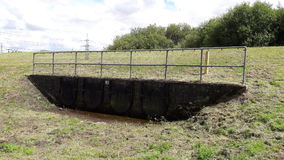 Floodwater outlet by River Rother Royalty Free Stock Image