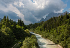 Floodwater running through valley in Dolomites Stock Photography