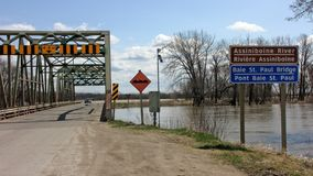 Floodwaters reach a Manitoba bridge Stock Photo