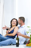 On the floor. Portrait of young happy couple in domestic environment Royalty Free Stock Photo