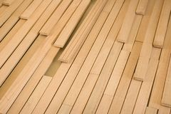 Floor Angle Pieces. The loose pieces of a hardwood floor installation Royalty Free Stock Images