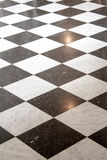 Floor with black and white tiles. Stock Image
