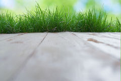 Floor bokeh background foreground green grass background. Wooden floor bokeh background foreground green grass background Royalty Free Stock Image