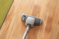 Floor Cleaning Action. Vacuum cleaner in motion cleaning parquet floor and carpet Stock Photo