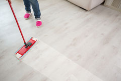 Floor cleaning action Stock Photo