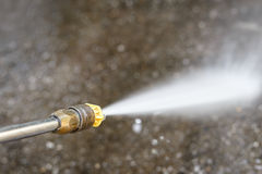 Floor cleaning with high pressure water jet Royalty Free Stock Photography