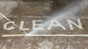 Floor cleaning with high pressure water jet Royalty Free Stock Image