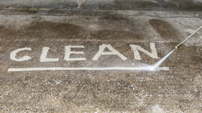Floor cleaning with high pressure water jet Stock Photography