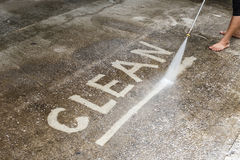 Floor cleaning with high pressure water jet Royalty Free Stock Photos