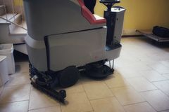 Floor cleaning machine with operator  board. Floor cleaning machine with operator on board Royalty Free Stock Images