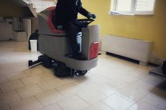 Floor cleaning machine with operator  board. Floor cleaning machine with operator on board Stock Images