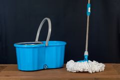 Floor cleaning with mob and bucket. On background royalty free stock photo