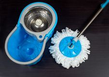 Floor cleaning with mob and bucket. On background royalty free stock image