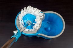 Floor cleaning with mob and bucket. On background royalty free stock photography