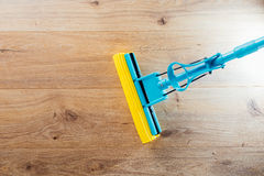 Floor cleaning with a mop Royalty Free Stock Image