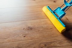 Floor cleaning with a mop Royalty Free Stock Photography
