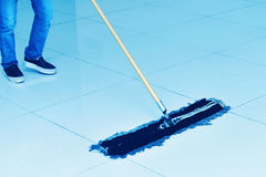 Floor cleaning. Cleaning process with mop and floor cloth,Cleaner with mop and uniform cleaning hall floor of public business building stock photography