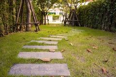 Floor corridor The stone. The stone walkway, green grass Stock Image