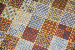 Tiled or linoleum floor covering with repeating square pattern Royalty Free Stock Image