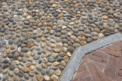 Floor design with terrace tiles and ornamental gravel Various materials for flooring in the garden Building materials. For gardening Professional gardening Royalty Free Stock Images