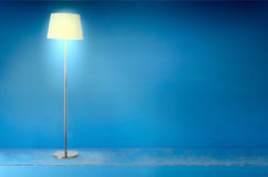 Floor electric lamp over blue stock image