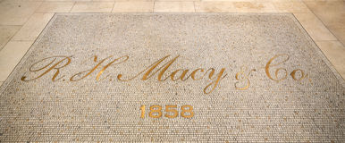 Floor at the entrance of the department store Macy`s. New York City, Usa - July 12, 2015: Mosaic on the floor at the entrance of the department store Macy`s in Royalty Free Stock Image