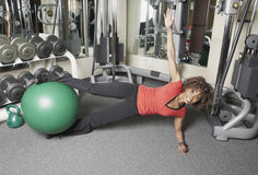 Floor excercise with gym ball Royalty Free Stock Photos