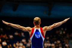 Floor exercise male gymnast Royalty Free Stock Photos