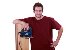 Floor fitter. Stood with planks of wood Stock Image