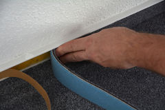 A floor fitters at work. A floor layers while working royalty free stock image