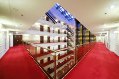 Floor with handrails, red carpet and doors to rooms royalty free stock images