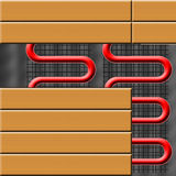 Floor heating. Fllor heating system partly under laminate flooring Royalty Free Stock Photography