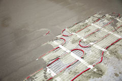Floor heating coils. Heating coils under a thin layer of concrete on a floor royalty free stock images