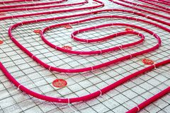 Floor heating pipe. Installation of engineering systems Stock Photo