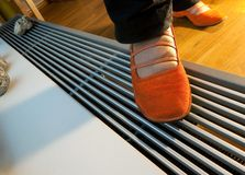 Floor heating and woman legs Royalty Free Stock Photos