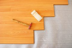 Floor installation. Work tools and uncompleted parqeut Royalty Free Stock Images