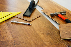 Floor installation example. The tools used to install laminate floors Royalty Free Stock Photo