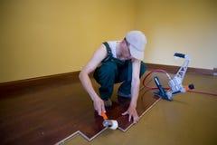 Floor installation. Home improvement with floor installation Stock Photo
