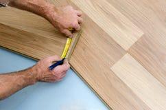 Floor installation. Home improvement. New floor installation Stock Images