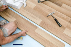 Floor installation. Home improvement. New floor installation Royalty Free Stock Photos