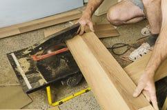 Floor installation. Home improvement. New floor installation Royalty Free Stock Photo